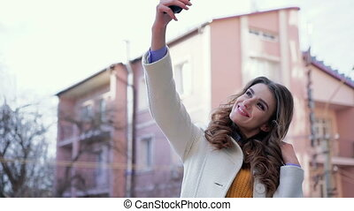 Business lady taking selfie in the background of the...