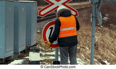 Worker to fix road sign