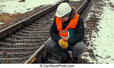 Railroad worker with adjustable wrench