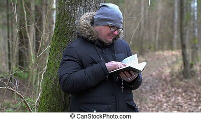 Man reading Bible at outdoor