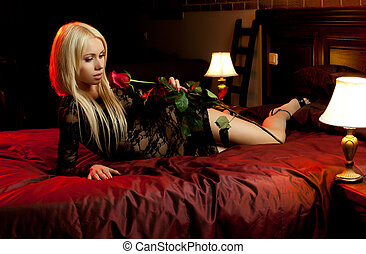 pretty girl - the beautiful young woman lie on bed with...