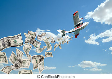 hydroplane and dollars - of hydroplane flying in blue sky,...