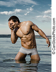 sexy man - the very muscular handsome sexy guy in water and...
