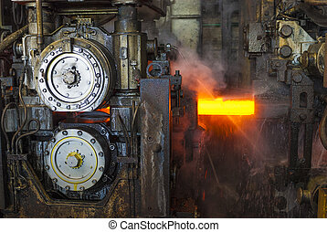 Steelworks - A steel incandescent bar in a steelworks