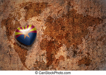 heart with arizona state flag on a vintage world map crack...