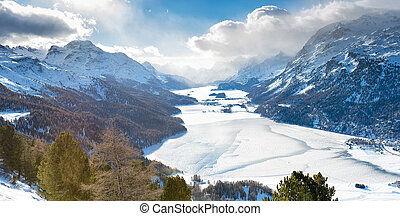 The valley of Engadine St. Moritz Switzerland with frozen...