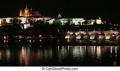 Prague at night with Charles Bridge Karluv Most over Vltava...