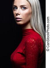 Dark portrait of a blonde woman in red dress - Fashion photo...