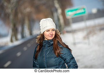 Woman in winter scenery