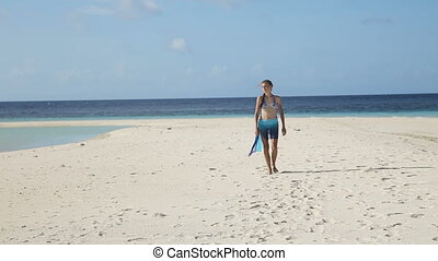 girl in silk tunic walking on the beach - The young...