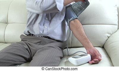 Man measuring his blood pressure - Senior man measuring his...