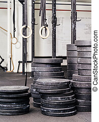 Stacks of weights at the gym - Background photo of stacks...