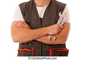 Young mechanic holding wrench in his hands isolated over white background - DIY