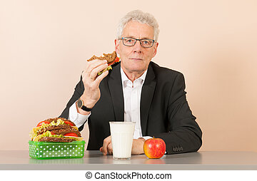 Senior business man eating healthy lunch - Senior business...