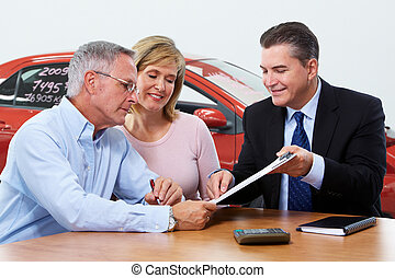 Senior couple with car dealer agent.
