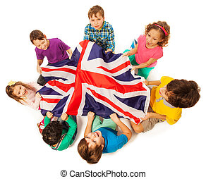 Kids with English flag in a middle of their circle - Top...