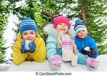 Kids play with snow together close portrait