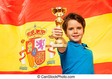 Happy winner with his cup against a flag of Spain - Happy...