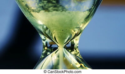 Sand Running Though An Hourglass - Sand Flowing Through An...