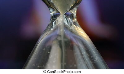 Hourglass - Extra Close Up. Sand Flowing Through An...