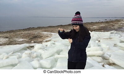Girl beautifully dances near the gulf during the winter...