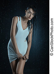 Wet woman in a dress.