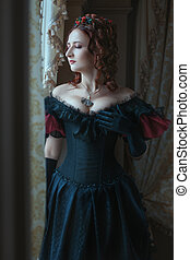 Graceful woman at the window. - Woman in Victorian dress...