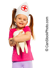 Funny little doctor with big tooth model - Funny little girl...