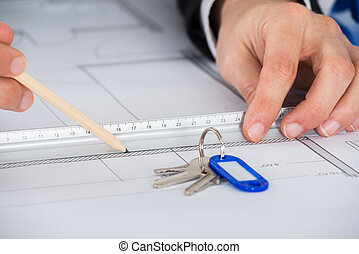 Close-up Of An Architect Working On Blue Print