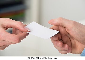 Businesspeople Exchanging Visiting Card - Close-up Of Two...