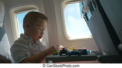 Child playing with toys during the flight