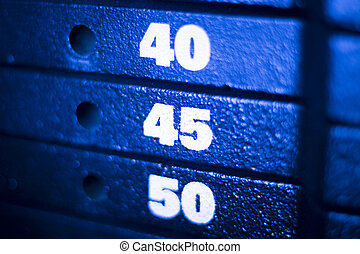 Weight training machine in fitness gym for weight training,...