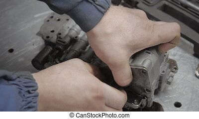 Auto Mechanic is Working on Engine in Car Repair Shop - Auto...