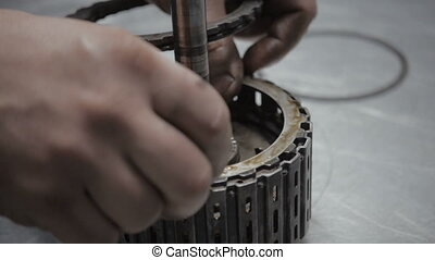 Engineer Hands Fixing Engine Power Transmission Gears Box -...