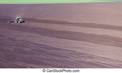 Aerial view of tractor plowing the soil. Nature, countryside