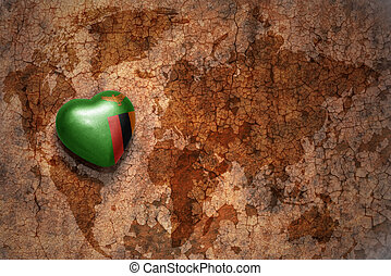 heart with national flag of zambia on a vintage world map...