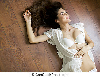 Woman laying on the floor