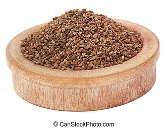 Ajwain seeds in a wooden bowl over white background