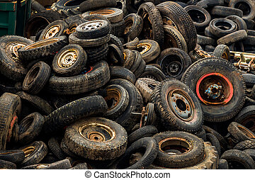 tires on junkyard - old car tires in a junkyard.