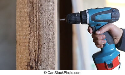 Use a screwdriver in the manufacture of wood products