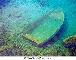 sunken boat - sunken wreck of a boat in the sea