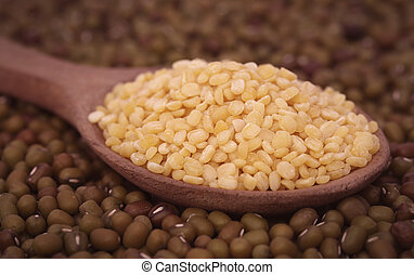 Dry mung bean in wooden spoon