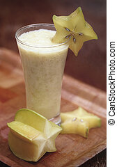 Carambola juice - Carambola or star fruits juice over white...