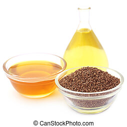 Ajwain seeds with essential oil over white background