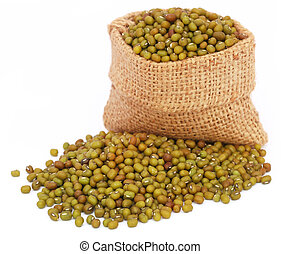Mung bean in jute bag over white background