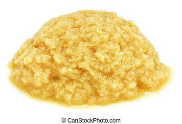 Mashed ginger over white background