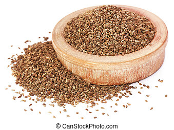 Ajwain seeds in a wooden bowl over white background - Ajwain...