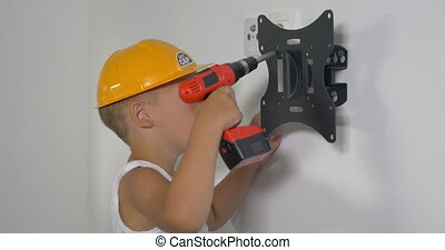 Little Workman with Electric Screwdriver - Little boy in...