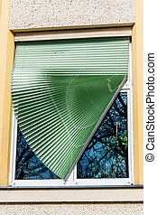broken blinds on a window at a school in linz, austria