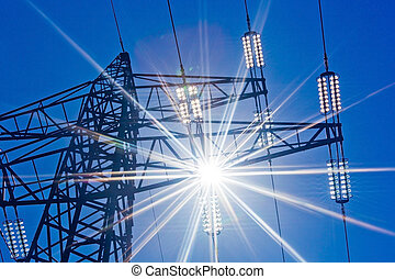 power line with sun - a pylons for electricity against a...